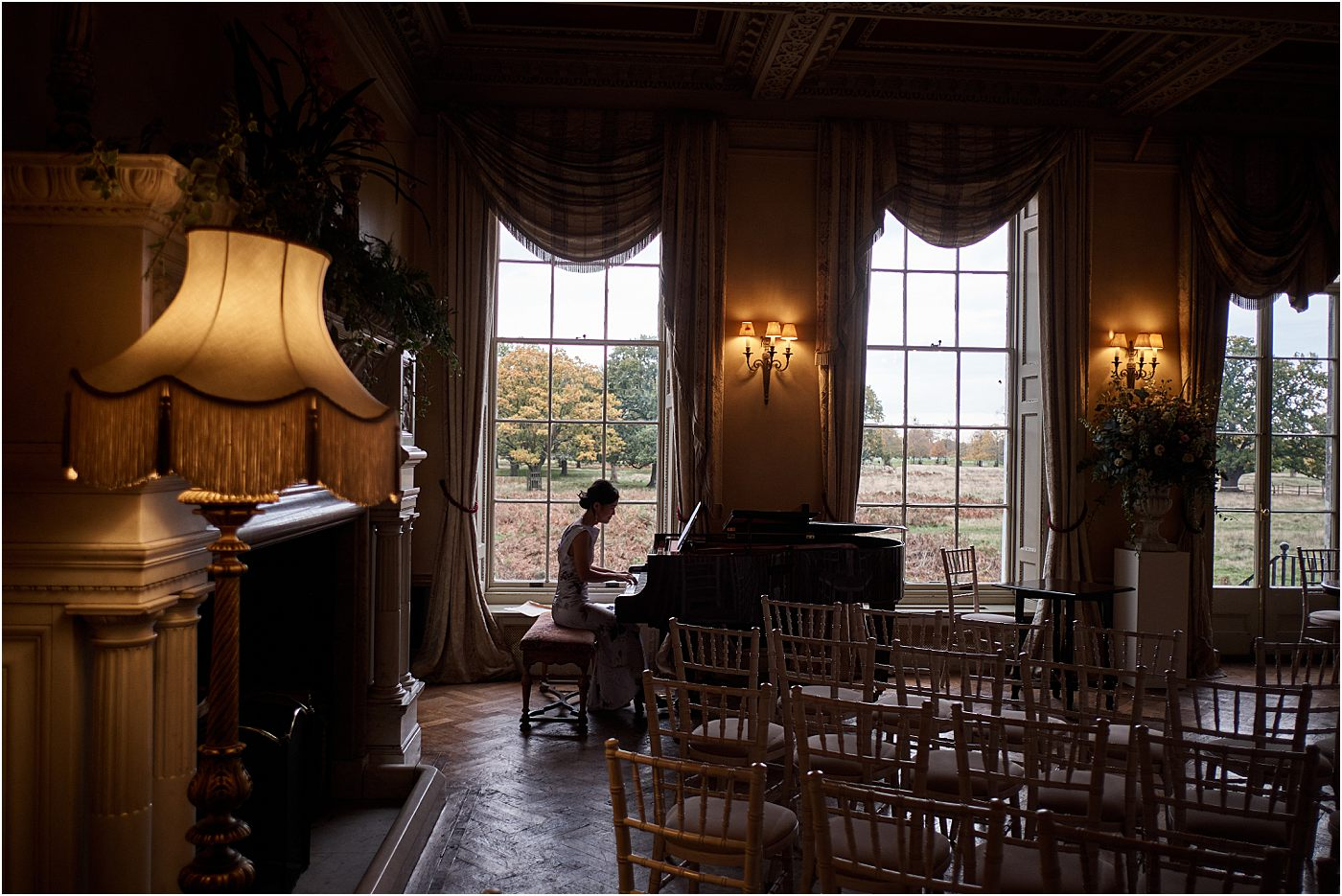 Playing the piano at Hampton Court House